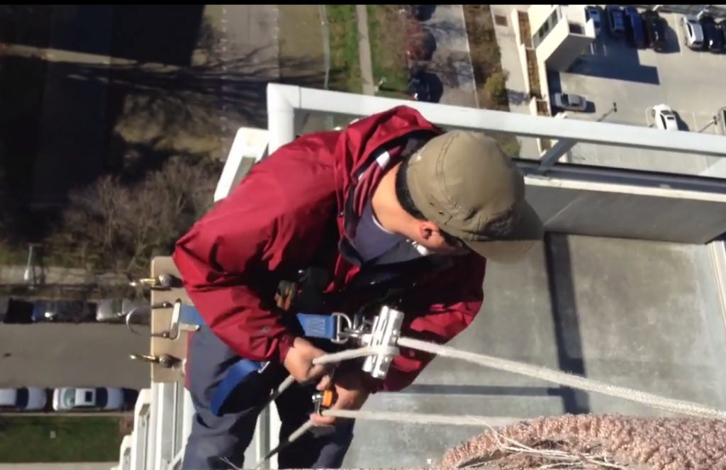 Cleaning Windows From the Top