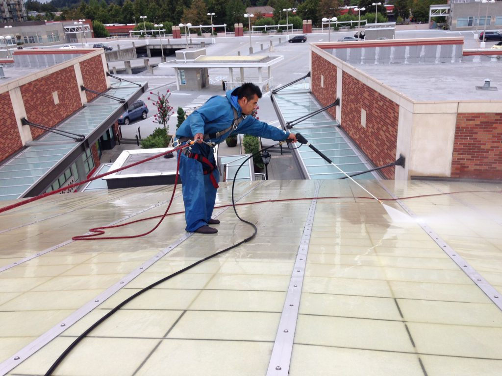 Pressure Washing Roof Top, Building & Sidewalks